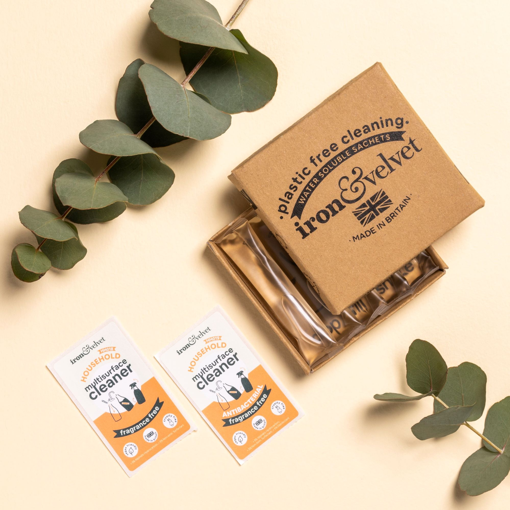 Flat lay image of our Fragrance free refill sachets in a open box with our labels. Foliage as decoration.